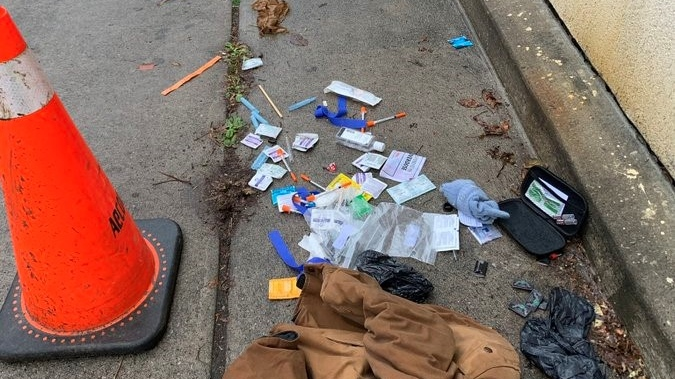 Drug paraphernalia is shown strewn on a  Cabbagetown street. A group of residents in Cabbagetown have resorted to hiring their own private security guard to patrol their neighbourhood amid concerns about crime in the area.