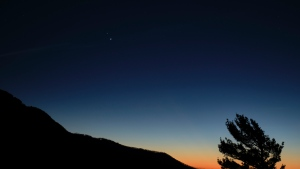 Saturn (top) and Jupiter (below) are seen after sunset from Shenandoah National Park, Sunday, December 13, in Luray, Virginia. (NASA/Bill Ingalis via CNN)