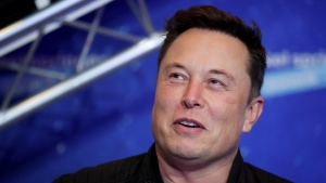 In this Tuesday, Dec. 1, 2020, file photo, SpaceX owner and Tesla CEO Elon Musk arrives on the red carpet for the Axel Springer media award, in Berlin. In a tweet Tuesday, Dec. 22, 2020, Musk said he once considered selling the electric car maker to Apple, but the iPhone maker's CEO Tim Cook blew off the meeting. (Hannibal Hanschke/Pool Photo via AP, File)