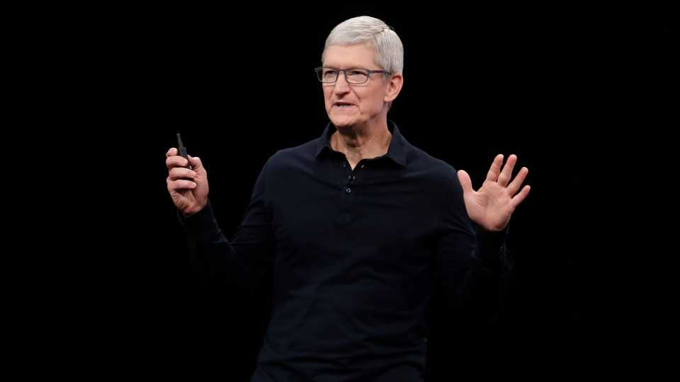In this June 3, 2019, file photo, Apple CEO Tim Cook speaks at the Apple Worldwide Developers Conference in San Jose, Calif. In a tweet Tuesday, Dec. 22, 2020, Tesla CEO Elon Musk said he once considered selling the electric car maker to Apple, but Cook blew off the meeting. (AP Photo/Jeff Chiu, File)