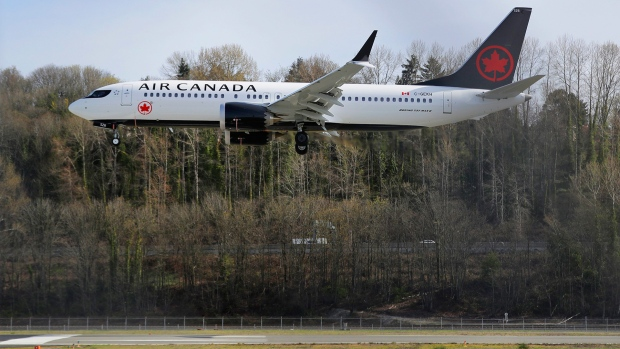 A Boeing 737 MAX 8 operated by Air Canada lands, Wednesday, March 27, 2019, at Boeing Field in Seattle. The Federal Aviation Administration plans to revamp oversight of airplane development after the two deadly crashes of 737 Max 8 airplanes, according to testimony prepared for a Capitol Hill hearing on Wednesday. (AP Photo/Ted S. Warren)