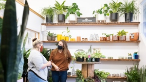 Employee Aja Burton (left) and store owner Kait Waugh chat at the Fat Plant Farm in Regina on Thursday Dec. 17, 2020. THE CANADIAN PRESS/Michael Bell