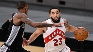 Toronto Raptors' Fred VanVleet (23) drives around San Antonio Spurs' Dejounte Murray during the second half of an NBA basketball game, Saturday, Dec. 26, 2020, in San Antonio. San Antonio won 119-114. (AP Photo/Darren Abate)