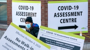 A man exits a COVID-19 Assesment Centre in Toronto on Friday, Dec. 18, 2020. THE CANADIAN PRESS/Frank Gunn