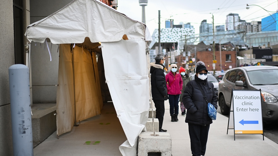 Front line healthcare workers wait in line to receive the Pfizer-BioNTech COVID-19 mRNA vaccine during the COVID-19 pandemic in Toronto on Tuesday, December 15, 2020. Toronto and Peel region continue to be in lockdown. THE CANADIAN PRESS/Nathan Denette