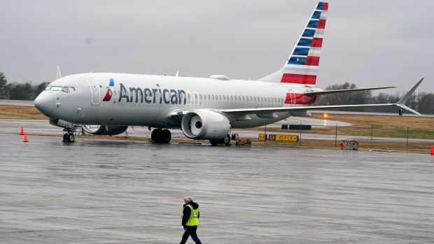 FILE - In this Dec. 2, 2020 file photo, an American Airlines Boeing 737 Max jet plane is parked at a maintenance facility in Tulsa, Okla. The American Airlines flight is scheduled to land at New York's LaGuardia Airport with about 100 passengers aboard, according to an airline spokeswoman. (AP Photo/LM Otero, File)