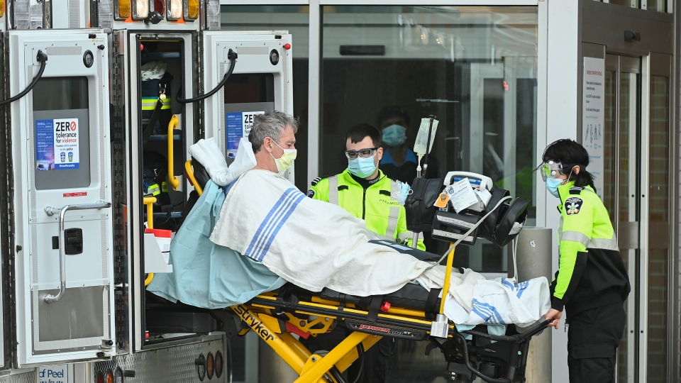 Paramedics unload a patient at an hospital emergency department in Mississauga, Ont., on Thursday, December 3, 2020. THE CANADIAN PRESS/Nathan Denette