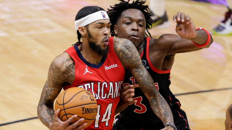 New Orleans Pelicans forward Brandon Ingram (14) drives to the basket as Toronto Raptors forward OG Anunoby (3) defends during the second half of an NBA basketball game on Saturday, Jan. 2, 2021, in New Orleans. (AP Photo/Butch Dill)