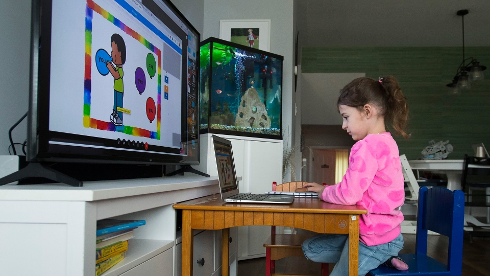 Six-year-old Peyton Denette works on her speech and language skills with speech-language pathologist Olivia Chiu of Two Can Talk remotely from her home in Mississauga, Ont., on Monday, March 30, 2020. THE CANADIAN PRESS/Nathan Denette