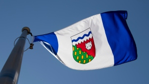 The Northwest Territories provincial flag flies on a flag pole in Ottawa, Monday July 6, 2020. THE CANADIAN PRESS/Adrian Wyld