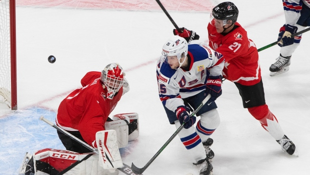 Russian Federation  advances to world junior semifinals with 2-1 win over Germany