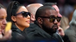 Kim Kardashian, left, and rapper Kanye West watch during the second half of an NBA basketball game between the Los Angeles Lakers and the Cleveland Cavaliers, Monday, Jan. 13, 2020, in Los Angeles. (AP Photo/Mark J. Terrill)