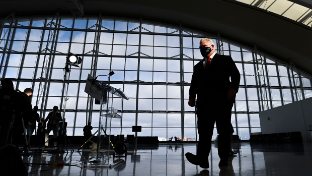 Ontario Premier Doug Ford leaves after holding a media availability regarding the new COVID-19 testing stations located at the international arrivals area at Pearson International Airport in Toronto on Wednesday, January 6, 2021. THE CANADIAN PRESS/Nathan Denette