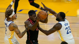 Toronto Raptors forward Pascal Siakam, middle, drives between Golden State Warriors guard Kelly Oubre Jr., left, and forward Draymond Green (23) during the first half of an NBA basketball game in San Francisco, Sunday, Jan. 10, 2021. (AP Photo/Jeff Chiu)