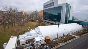 A mobile field hospital sits beside Joseph Brant Hospital in Burlington, Ont. on Tuesday January 6, 2021. The mobile hospital is now active with patients this week as a worsening wave of COVID-19 infections pushes the health-care system to its limits. THE CANADIAN PRESS/Frank Gunn