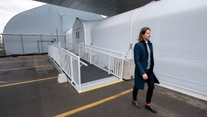 Infectious Disease Specialist Dr. Dale Kalina walks down a ramp from the mobile field hospital beside Joseph Brant Hospital in Burlington, Ontario on Tuesday January 6, 2021. The mobile hospital is now active with patients this week as a worsening wave of COVID-19 infections pushes the health-care system to its limits. THE CANADIAN PRESS/Frank Gunn