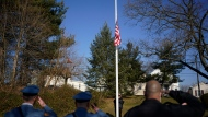 Police officers salute as a flag is lowered to honor U.S. Capitol Police Officer Brian Sicknick at his home town of South River, N.J., Tuesday, Jan. 12, 2021. From his early days growing up in a New Jersey hamlet, Sicknick wanted to be a police officer. He would join the U.S. Capitol Police in 2008, where he served until his death Thursday after being attacked as rioters seething over President Donald Trump's election loss stormed the U.S. Capitol. (AP Photo/Seth Wenig)