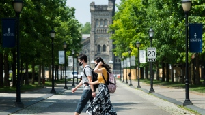 People walk past the University of Toronto campus during the COVID-19 pandemic in Toronto on Wednesday, June 10, 2020. THE CANADIAN PRESS/Nathan Denette