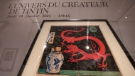 "The inked and water-painted original panel of the comic character Tintin from the 1936 ""The Blue Lotus"" album drawn by Belgian creator Herge, is displayed at the Artcurial auction house in Paris, Wednesday, Jan. 13, 2021. The art work with an estimates value of 2.2 to 2.8 million euros (US $ 2.6 to 3.4 million), is going on sale Thursday. (AP Photo/Michel Euler)"