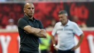 New York Red Bulls head coach Chris Armas, left, watches his team from the sideline while New York City FC head coach Domenec Torrent looks on during the second half of an MLS soccer match, Sunday, July 14, 2019, in Harrison, N.J.  (AP Photo/Steve Luciano, File)