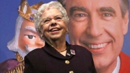 "FILE - Joanne Rogers stands in front of a giant Mister Rogers Forever Stamp following the first-day-of-issue dedication in Pittsburgh on March 23, 2018. Rogers, the widow of Fred Rogers, the gentle TV host who entertained and educated generations of preschoolers on ""Mister Rogers' Neighborhood,"" has died. She was 92. (AP Photo/Gene J. Puskar, File)"