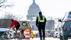 A Capitol Hill police officer works a checkpoint near the Capitol Building on Capitol Hill in Washington, Thursday, Jan. 14, 2021. (AP Photo/Andrew Harnik)
