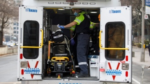 Paramedics wipe down equipment inside an ambulance outside the emergency department at Mount Sinai Hospital in Toronto, Wednesday, Jan. 13, 2021. THE CANADIAN PRESS/Cole Burston