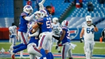 Buffalo Bills' Matt Milano (58) celebrates with teammates after an NFL wild-card playoff football game against the Indianapolis Colts Saturday, Jan. 9, 2021, in Orchard Park, N.Y. The Bills won the game 27-24. (AP Photo/Jeffrey T. Barnes)