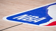 FILE - In this Sept. 2, 2020, file photo, the NBA logo is displayed at center court during an NBA first-round playoff basketball game between the Houston Rockets and Oklahoma City Thunder in Lake Buena Vista, Fla. (AP Photo/Mark J. Terrill, File)