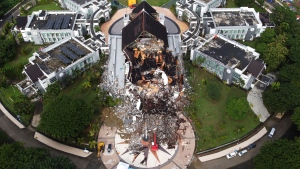 A government building is seen badly damaged following an earthquake in this aerial photo taken using a drone in Mamuju, West Sulawesi, Indonesia, Saturday, Jan. 16, 2021. Damaged roads and bridges, power blackouts and lack of heavy equipment on Saturday hampered Indonesia's rescuers after a strong and shallow earthquake left a number of people dead and injured on Sulawesi island. (AP Photo/Abdi Latief)