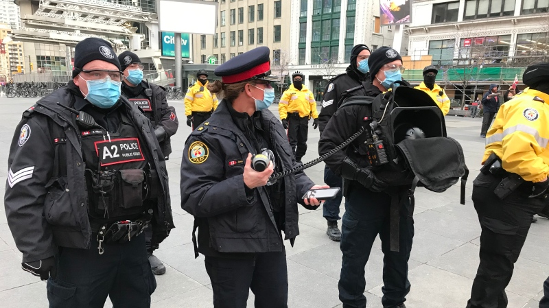 Police break up a gathering of anti-lockdown protesters at Yonge-Dundas Square. (CTV News/Craig Wadman)