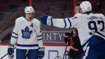 Toronto Maple Leafs centre Joe Thornton races to congratulate teammate Auston Matthews on his goal as Ottawa Senators left wing Brady Tkachuk looks on during first period NHL hockey action in Ottawa, Saturday, Jan. 16, 2021. THE CANADIAN PRESS/Adrian Wyld