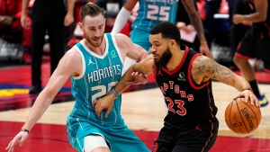 Toronto Raptors guard Fred VanVleet (23) works against Charlotte Hornets forward Gordon Hayward (20) during the first half of an NBA basketball game Saturday, Jan. 16, 2021, in Tampa, Fla. (AP Photo/Chris O'Meara)