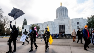 Protesters who identified themselves as Liberty Boys gather outside the Oregon State Capitol on Sunday, Jan. 17, 2021, in Salem, Ore. The group said they want reduced government and do not support President Donald Trump or President-elect Joe Biden. (AP Photo/Noah Berger)