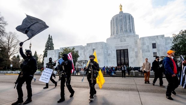 Heavily fortified statehouses around U.S. see small protests