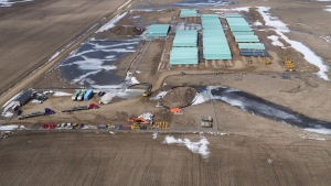 In this April 13, 2020, photo provided by TC Energy, a pipe storage yard with material for construction of the Keystone XL oil pipeline is seen at a staging area along the U.S.-Canada border north of Glasgow, Mont.  (TC Energy via AP)