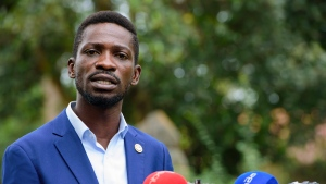 The National Unity platform presidential candidate Bobi Wine addresses the media at his home in Magere, Uganda, Friday, Jan. 15, 2021. Uganda's electoral commission says President Yoweri Museveni leads in Thursday's election with results in from 29% of polling stations. He has 63% of ballots while top opposition candidate Bobi Wine has 28%. Wine, a popular singer-turned-lawmaker half the president's age, alleges that the vote in the East African country was rigged. (AP Photo/Nicholas Bamulanzeki)