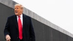 President Donald Trump reacts after speaking near a section of the U.S.-Mexico border wall, Tuesday, Jan. 12, 2021, in Alamo, Texas. (AP Photo/Alex Brandon)