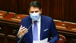 Premier Giuseppe Conte addresses the lower chamber of Parliament, in Rome, Monday, Jan. 18, 2021. Conte fights for his political life with an address aimed at shoring up support for his government, which has come under fire from former Premier Matteo Renzi's tiny but key Italia Viva (Italy Alive) party over plans to relaunch the pandemic-ravaged economy. (Guglielmo Mangiapane/Pool photo via AP)