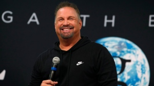"Country musician Garth Brooks jokes with reporters during a news conference in Mile High Stadium, Friday, June 7, 2019, in Denver. Brooks is making a stop Saturday in Denver as part of ""The Garth Brooks Stadium Tour."" (AP Photo/David Zalubowski)"
