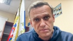 In this image taken from video released by Navalny Life youtube channel, Russian opposition leader Alexei Navalny speaks as he waits for a court hearing in a police station in Khimki, outside in Moscow, Russia, Monday, Jan. 18, 2021. (Navalny Life youtube channel via AP)