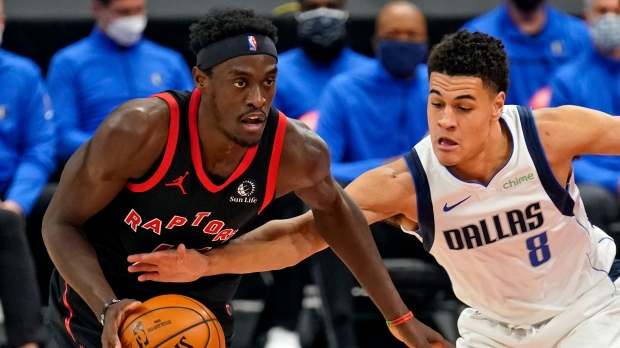 Dallas Mavericks guard Josh Green (8) reaches in an attempt to knock the ball away from Toronto Raptors forward Pascal Siakam (43) during the first half of an NBA basketball game Monday, Jan. 18, 2021, in Tampa, Fla. (AP Photo/Chris O'Meara)