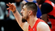 Toronto Raptors center Alex Len (27) celebrates a three-point basket during the second half of an NBA basketball game against the New York Knicks Thursday, Dec. 31, 2020, in Tampa, Fla. (AP Photo/Chris O'Meara)