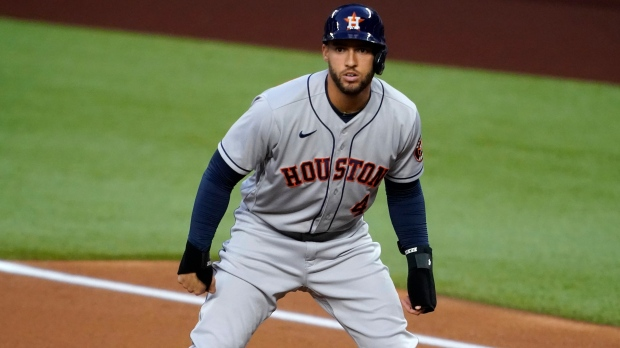 In this Sept. 25, 2020, file photo, Houston Astros' George Springer takes a lead off first during the first inning of the team's baseball game against the Texas Rangers in Arlington, Texas. Springer became the most prominent among baseball's free agents to reach an agreement, a $150 million, six-year contract with the Toronto Blue Jays, a person familiar with the negotiations told The Associated Press. The person spoke on condition of anonymity Tuesday night, Jan. 19, 20201, because the deal was subject to a successful physical. (AP Photo/Tony Gutierrez, File)