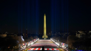 A field of flags is spread across the National Mall, with the Washington Monument in the background on Tuesday, Jan. 19, 2021, as seen the the West Front of the U.S. Capitol on the evening ahead of the 59th Presidential Inauguration in Washington. (AP Photo/Susan Walsh)