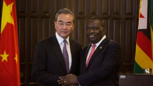 China's Foreign Minister Wangi Yi, left, greets Zimbabwe's Foreign Minister Sibusiso Moyo after a joint press conference in Harare, Zimbabwe, Sunday, Jan, 12, 2020. (AP Photo/Tsvangirayi Mukwazhi)