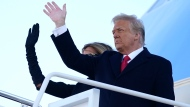 President Donald Trump and first lady Melania Trump board Air Force One at Andrews Air Force Base, Md., Wednesday, Jan. 20, 2021.(AP Photo/Manuel Balce Ceneta)