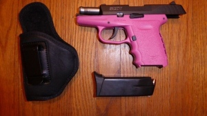 A prohibited handgun seized by police in a smuggling probe is seen in a TPS handout image.