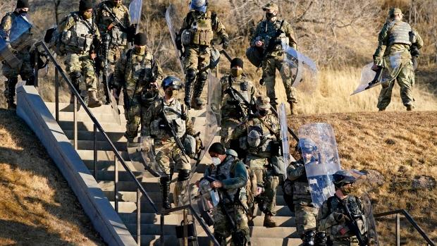 Utah National Guardsmen arrive at the Utah State Capitol Wednesday, Jan. 20, 2021, in Salt Lake City. (AP Photo/Rick Bowmer)
