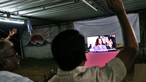 Villagers shout slogans to celebrate as they watch a live telecast of Kamala Harris being sworn in as U.S. Vice President during the inauguration ceremony, in Thulasendrapuram, the hometown of Harris' maternal grandfather, south of Chennai, Tamil Nadu state, India, Wednesday, Jan. 20, 2021. (AP Photo/Aijaz Rahi)